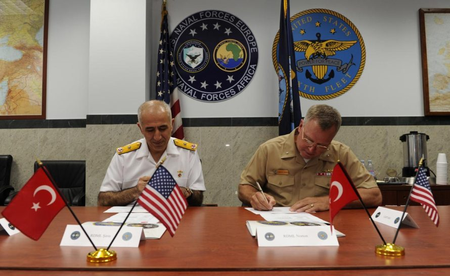 "Rear Adm. Aydin Sirin (left) and Rear Adm. Kenneth ""K.J."" Norton (right) signing the minutes. Photo: U.S. Navy by Mass Communication Specialist 1st Class Christopher B. Stoltz/Released"