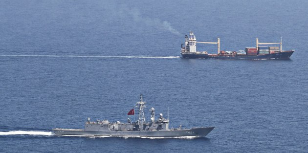 TCG Gökova escorting the merchant vessel M/V Aqua Luna in Gulf of Aden. Photo: Official Turkish Navy Photo.