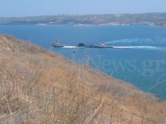 Two tugs assits the grounded submarine Proteus. Photo: Flashnews.gr