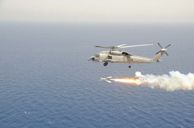 One Turkish Seahawk helicopter is firing a AGM-114 Penguin missile to LST Serdar.