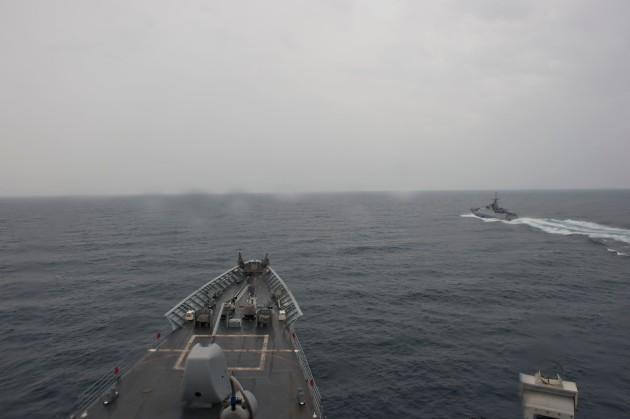 140808-N-ZE250 118  BLACK SEA, (Aug. 8, 2014) Turkish Navy vessel TCG Tuzla (P1200) steams past Ticonderoga-class guided-missile cruiser USS Vella Gulf (CG 72) after completing maneuvering exercises in the Black Sea. Vella Gulf, homeported in Norfolk, Va., is conducting naval operations with allies in the U.S. 6th Fleet area of operations in order to advance security and stability in Europe. (U.S. Navy photo by Mass Communication Specialist 3rd Class Weston Jones/Released)